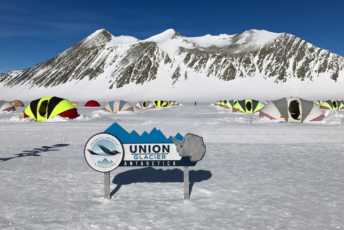 02A ALE Union Glacier Antarctica Sign And Very Comfortable Clam Tents With Mount Rossmann Beyond.jpg